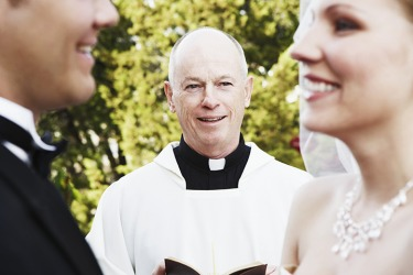 The priest pronounced the couple husband and wife.