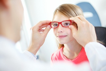 The young girl is getting glasses that are proportional to the size of her face.