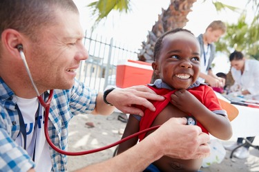 The doctors volunteer to provide medical care to needy families.