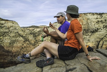 A couple taking a break to snack on the provisions they packed.