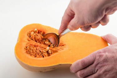 You should scoop the pulp out of a butternut squash before baking.