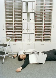 He was pummeled by the files when he fell off of the step stool.