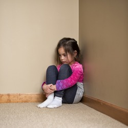 The mom punished her daughter for talking back and made her sit in the corner to think about her actions.