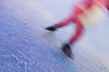 The blurred image of a skater in motion.