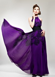A model wearing a purple dress.