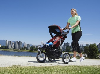 A mom pushes a stroller.