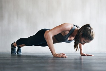 Her crossfit routine works in push-ups.