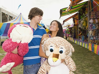 His quixotic strategy to impress his date by winning the large stuffed animals for her at the carnival seemed to be working.