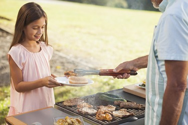 Radiant energy produced by a barbecue grill gives food a delicious flavor.