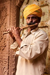 The musician played familiar raga tunes with his treasured flute.