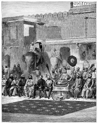 A rajah sitting on a throne in a ceremonial gathering under British rule.