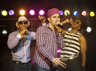 A rap group performing on stage.