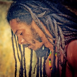 The Rastafarian does not cut his hair because that is part of his belief.