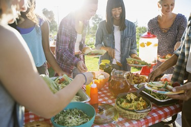 It's always a huge feast when the group of friends get together for a potluck picnic because of their mutual reciprocity in which everyone brings an amazing dish.