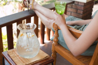 A relaxing Saturday afternoon spent sipping ice-cold lemon water on the front porch allows Cheryl to recuperate after a stressful work week.
