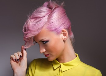 The 1980's neon hair redux, a la Cindy Lauper, has become fashionable again.