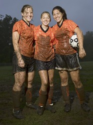 The soccer team was completely covered in mud by the end of the game.