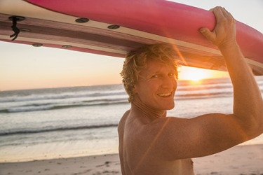 Scott's favorite time to surf is first thing in the morning when the sun is just coming over the horizon.