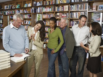 Part of publishing a book involves marketing which can include attending book signings at a bookstore.