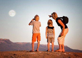 Michelle pointed out the rising moon to her children while on a hike in the canyon.