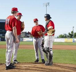 The baseball players had a discussion on the mound to determine if the pitcher should be relieved.