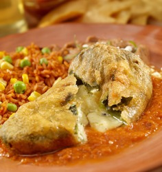 Chile relleno's are poblano chiles stuffed with a white cheese, then battered and fried.