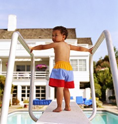 Bradon showed some reluctance as inched to the end of the diving board even though his father was waiting to catch him.