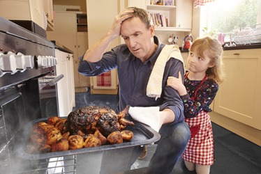 Violet's dad was remiss in keeping an eye on the chicken roasting in the oven and now dinner is ruined.
