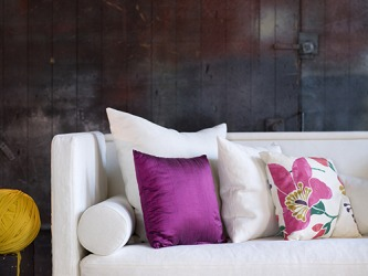 The removable decorative pillow covers can be changed out very easily because they have a zipper closure.