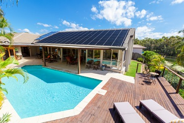 To heat the pool and power the home without relying on fossil fuel, solar panels can be installed to harness the renewable energy of the sun.