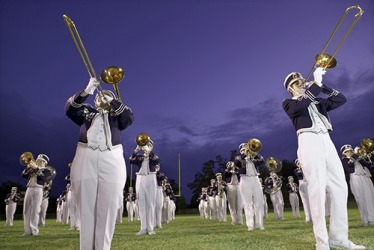 The high school marching band's repertoire of songs includes classic as well as pop music favorites.