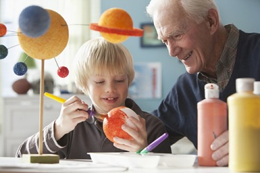 Andrew and his grandfather are creating a replica of the solar system.
