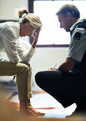 Even though Sylvia was still emotionally shaken, she was willing to give the police officer a report of the incident.