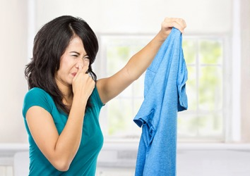 The repugnant odor from the shirt could only be eliminated by a thorough washing in hot, soapy water.
