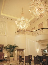 The resplendent crystal chandeliers create an atmosphere of elegance in the hotel lobby.