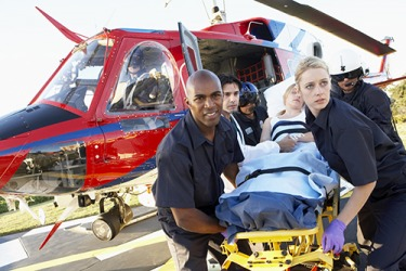 The rescue respondents secured the injured woman before getting her into the helicopter.
