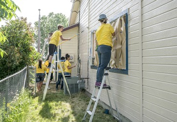 As restitution for spray painting the school's wall, Sam was ordered by the juvenile court to work with a volunteer group repainting a needy family's house.