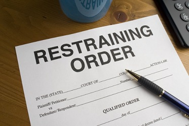 The woman filed a restraining order against her former boyfriend because he came to her place of work.