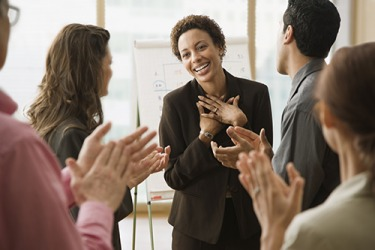 Cynthia's usual reticence at the office melted away when everyone congratulated her on her recent promotion.