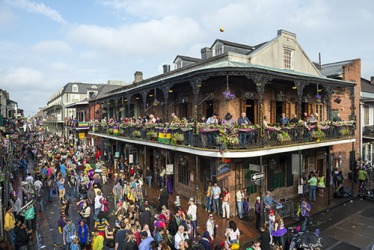 Crowds of people revel at the Mardi Gras festivities in New Orleans every year.