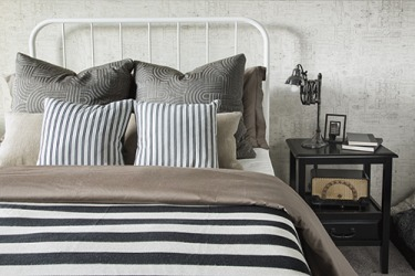 Decorating with a reversible comforter gives the homeowner more styling options.