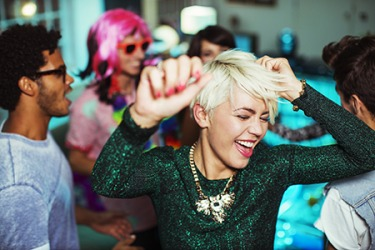 The rhapsodic music at the club gets everyone out on the dance floor.