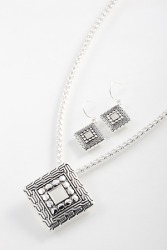 A rhombus shaped necklace and earrings set.