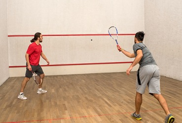 In the sport of racquetball, the ball can ricochet off all of the walls and still be in play.