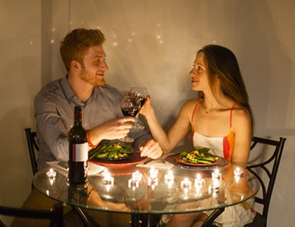 William invited his girlfriend over to his apartment for a candlelight dinner hoping to intensify the romance in their relationship.