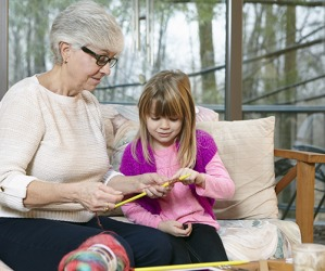 Emily's grandmother is teaching her the rudiments of knitting by first showing her how to cast-on.