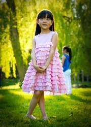 Amelia wore her favorite pink ruffly dress to her friend's birthday party in the park.