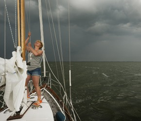 Marla lowered the sails while her husband radioed in an S.O.S. call because they couldn't outchase the storm.