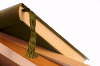 A book with a ribbon bookmark.
