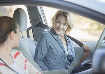 Lynette is always concerned about her daughter's safety and makes sure she buckles her seatbelt before starting the car.